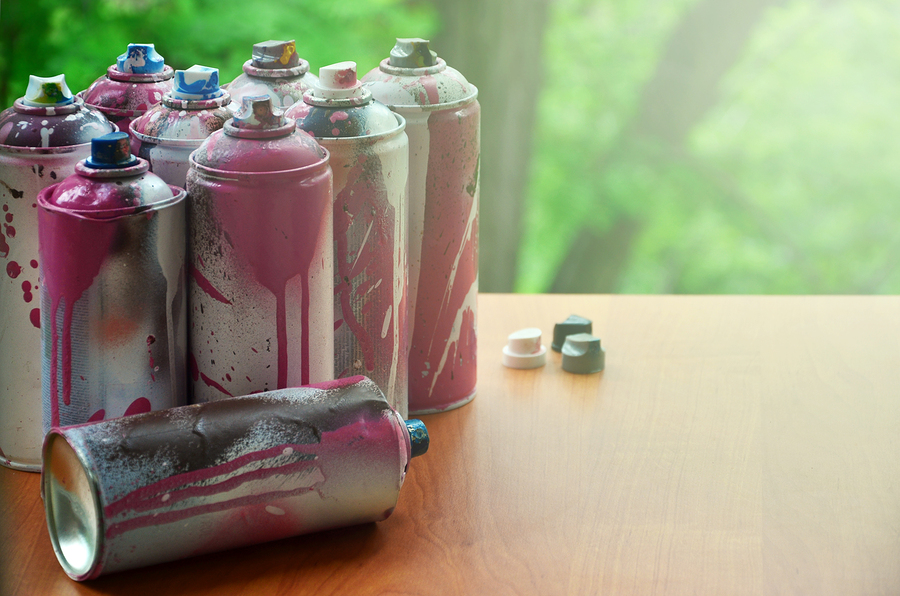 A Lot Of Used Spray Cans Of Paint Close-up