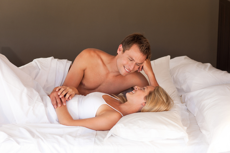 Smiling couple lying together.