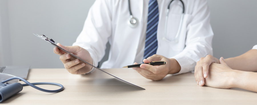 Medical doctor reviewing a chart.