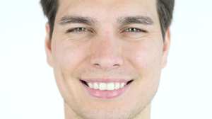 Man smiling with white teeth showing.