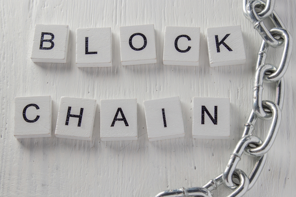 Blockchain word made from white blocks.