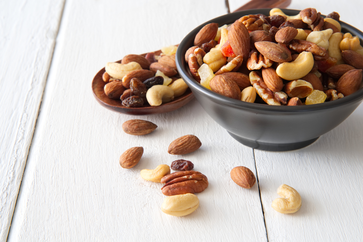Tabletop with a bowl of mixed nuts.