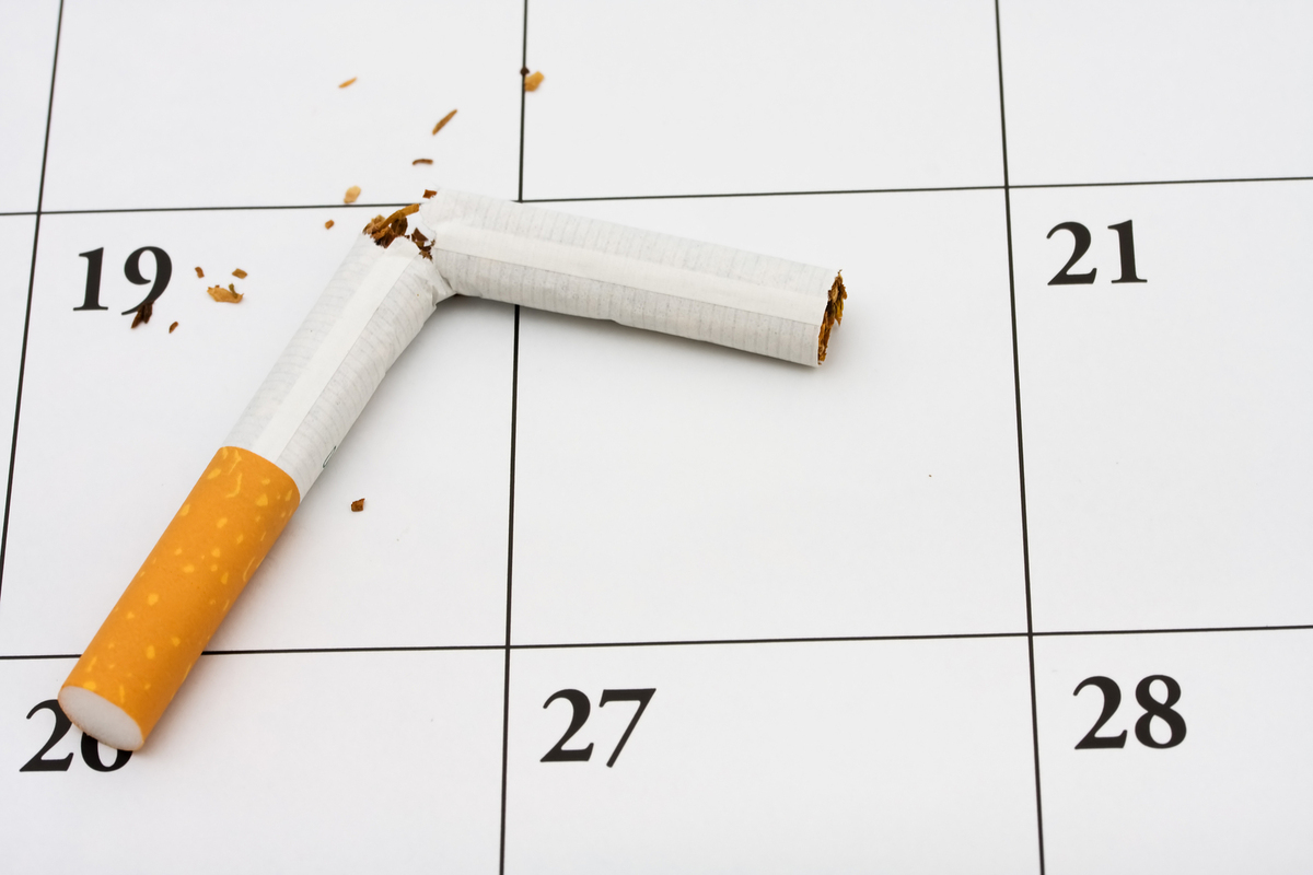 Calendar with a broken cigarette.