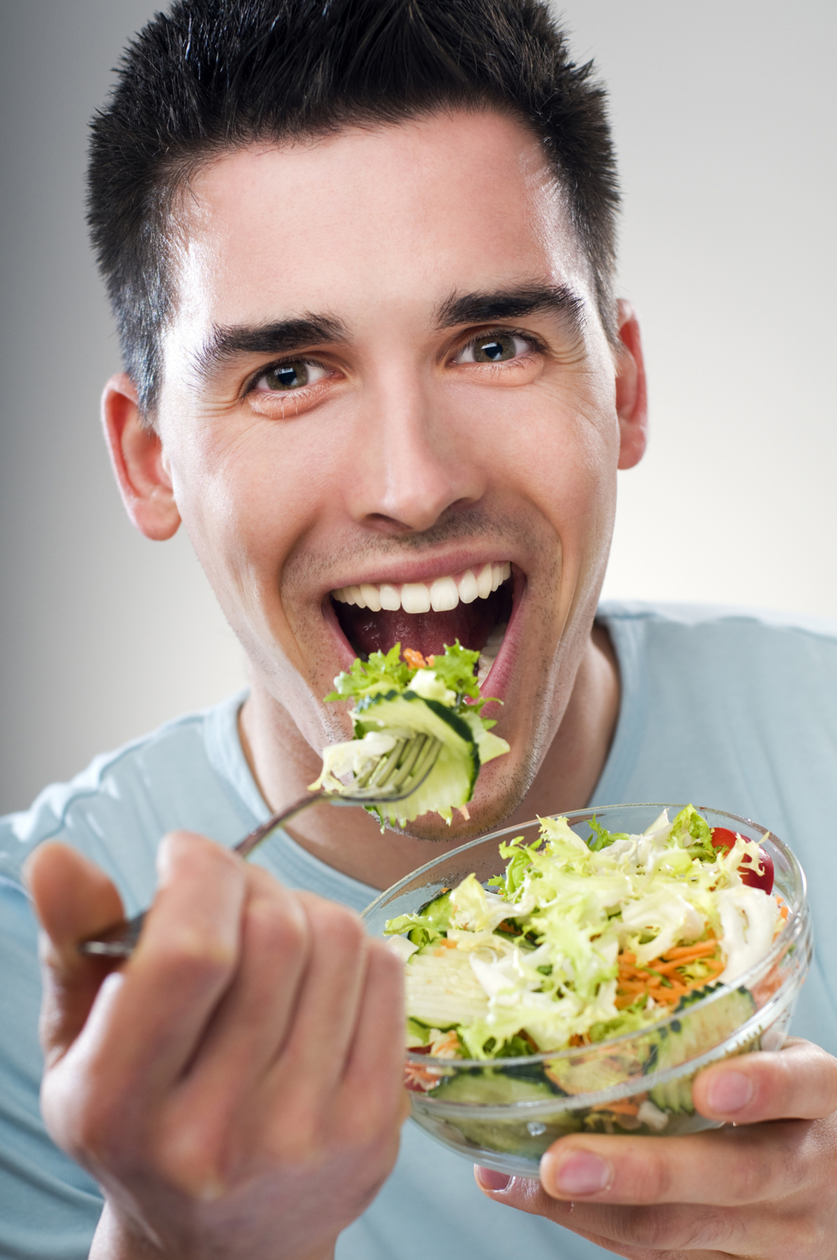Man eating a salad.