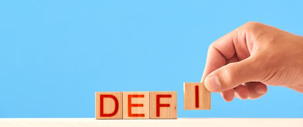 DEFI letters on wooden blocks.