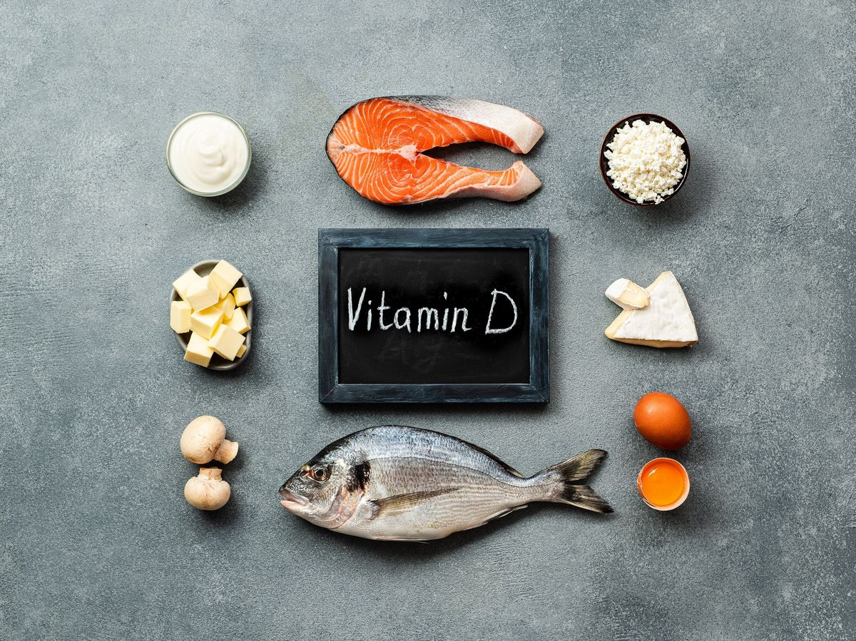 Chalk board labeled vitamin D with fish, mushrooms, cheese and cream.