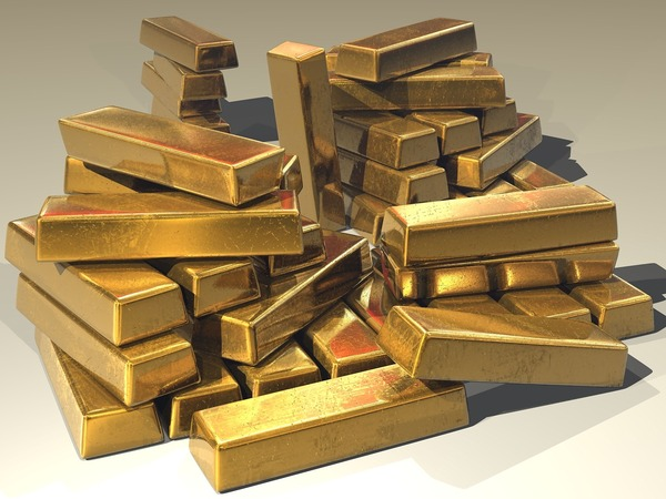 Multiple gold bars in a pile.