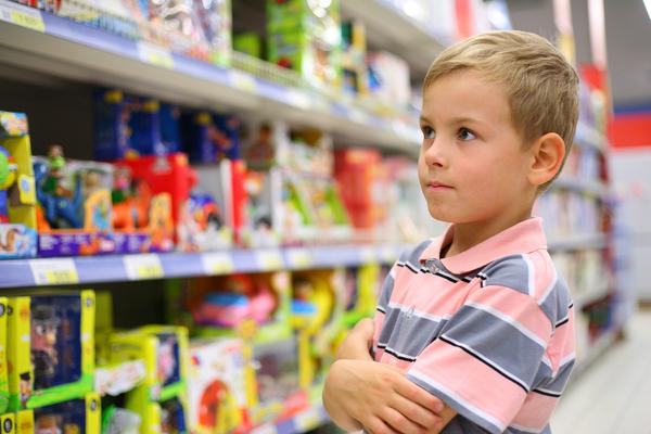 Boy shopping for toys.