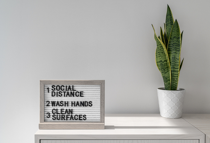 Social distance, wash hands and clean surfaces sign.