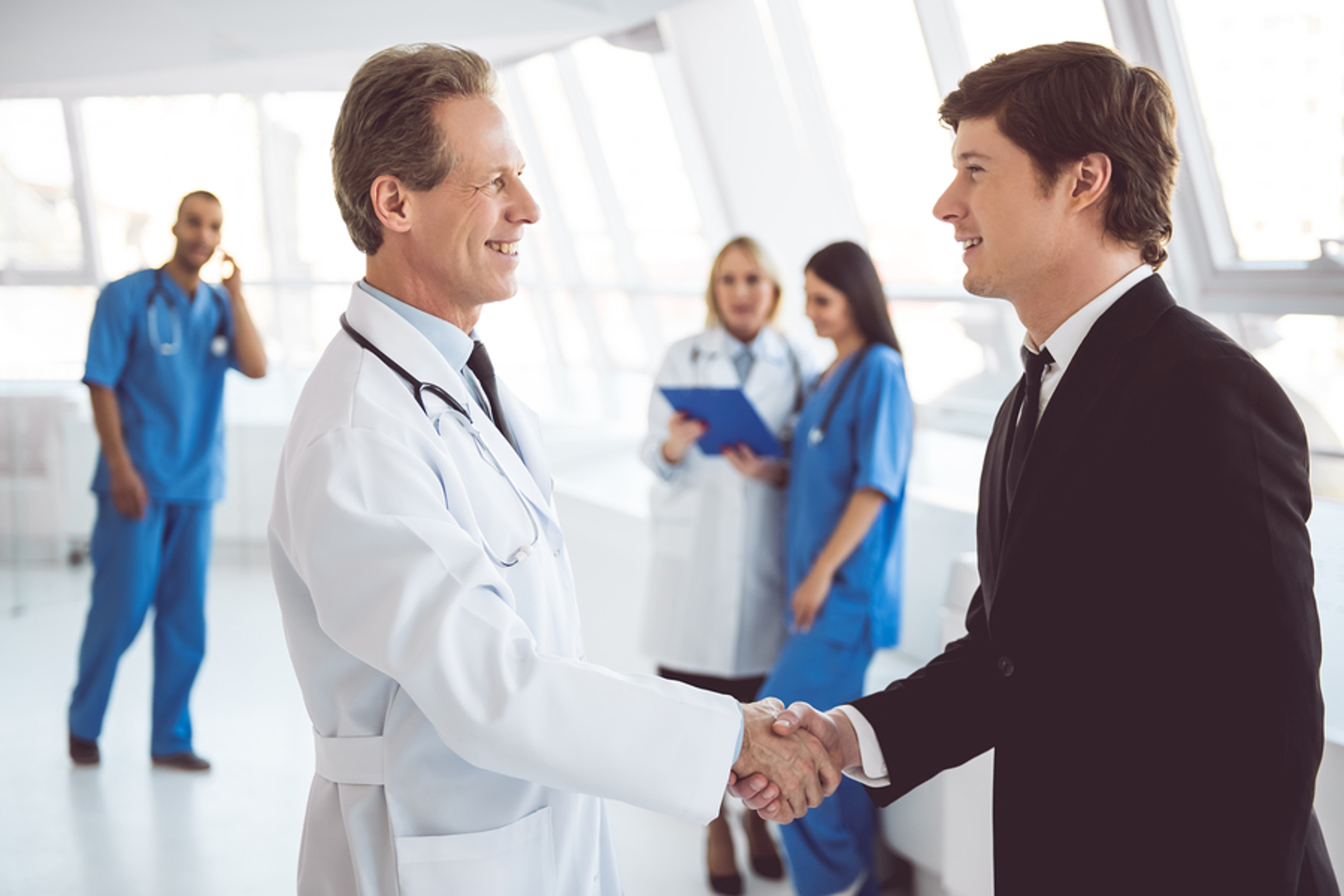 Medical doctor shaking the hand of a patient.