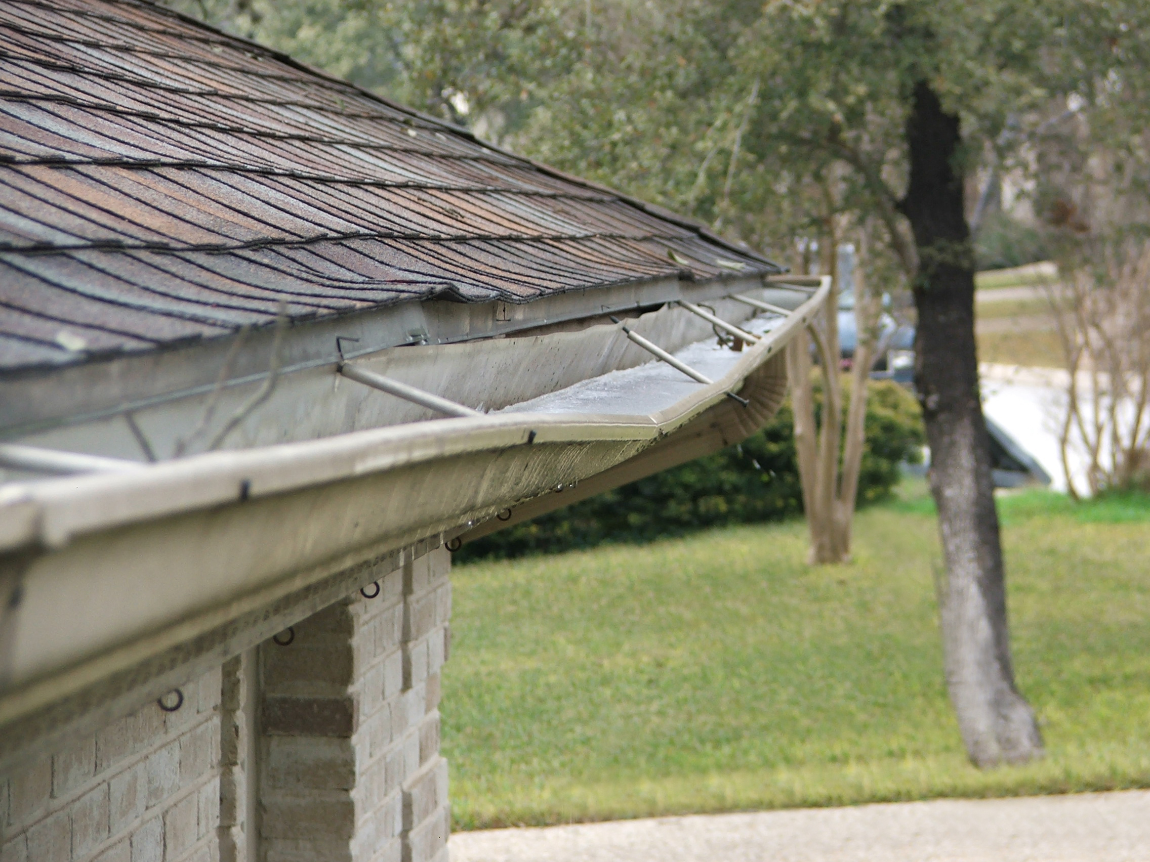 How to install a downspout in a gutter - Why Gutter Slope Is Essential To Your Home