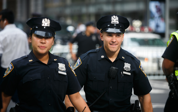 Two police officers in uniform.