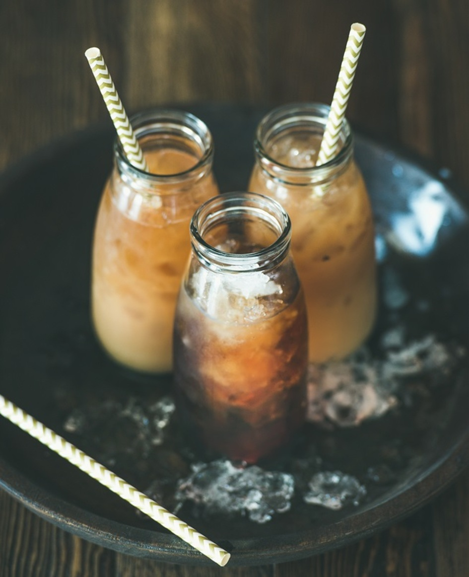 Three glass jars filled with cold brew coffee.