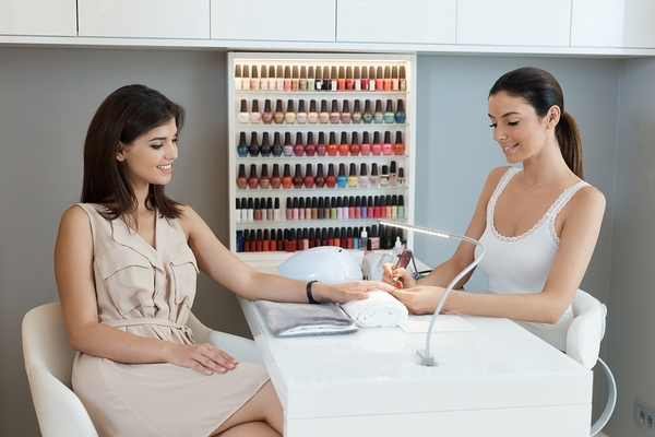 Woman getting her nails done at a beauty salon.