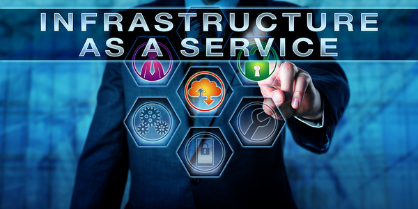 Man with a digitally created graphic with the words Infrastructure as a service.