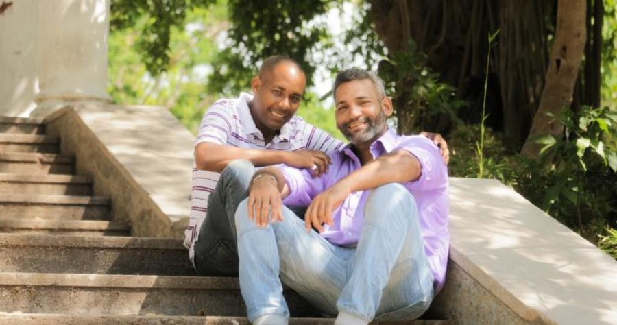 Two men sitting on the steps together.