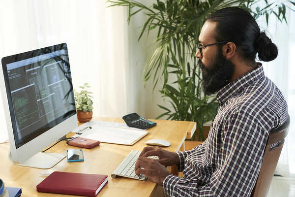 Blockchain developer working at his desk.