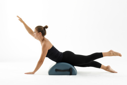Half circle prop can be used as part of a Pilates workout
