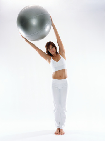 For a variant in your Pilates workout, the balance ball is a good prop to use.