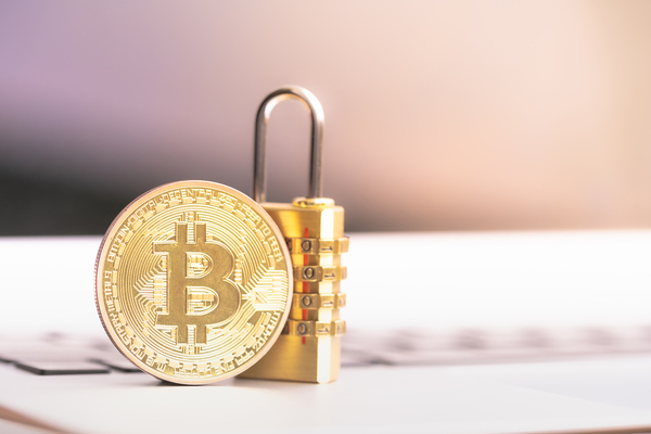 Gold coin with a bitcoin symbol and a combination lock.