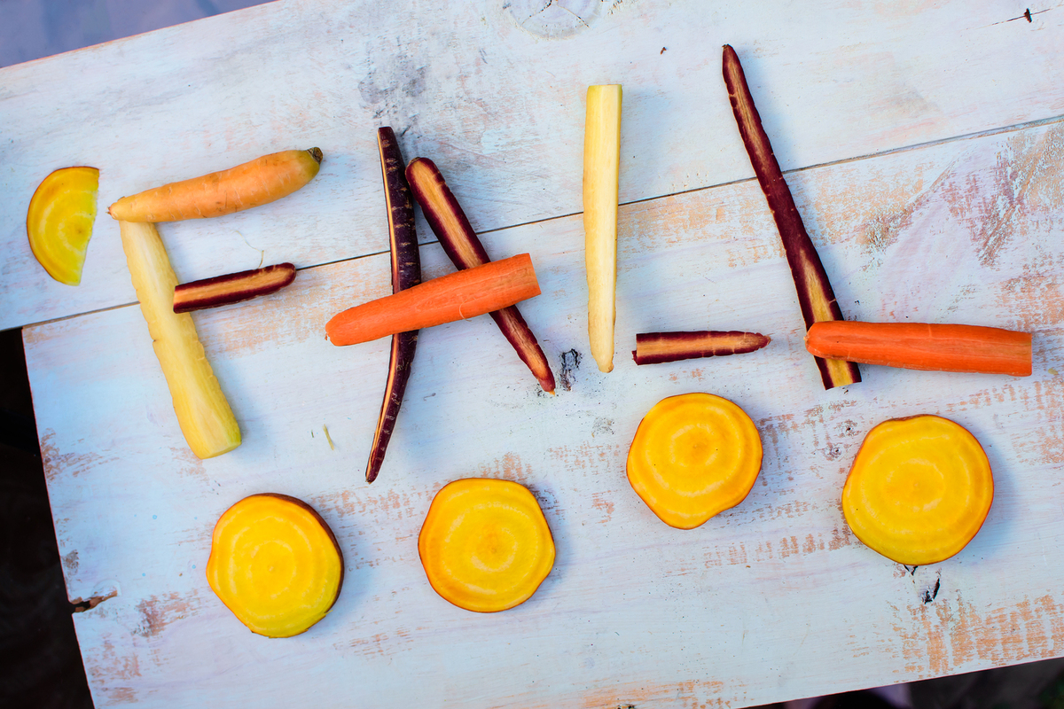 The word fall spelled out with vegetables.