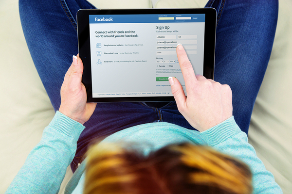 Person signing up for a Facebook account.