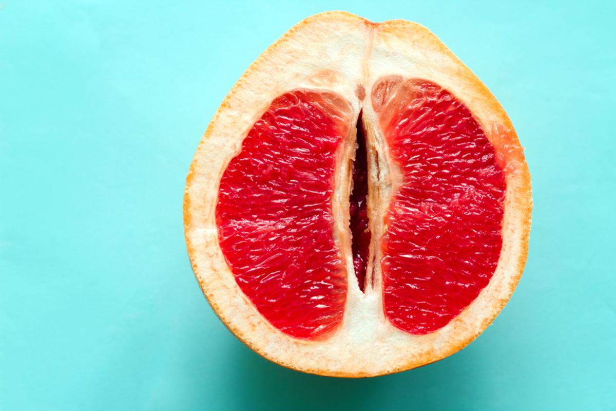 Red grapefruit cut in half.