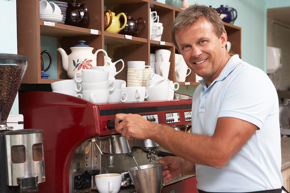 Business man making coffee in a shop.