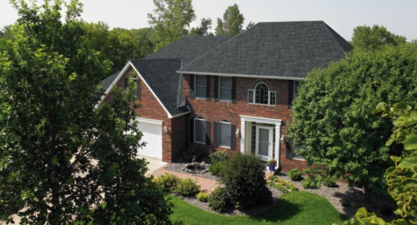 Brick house with trees.