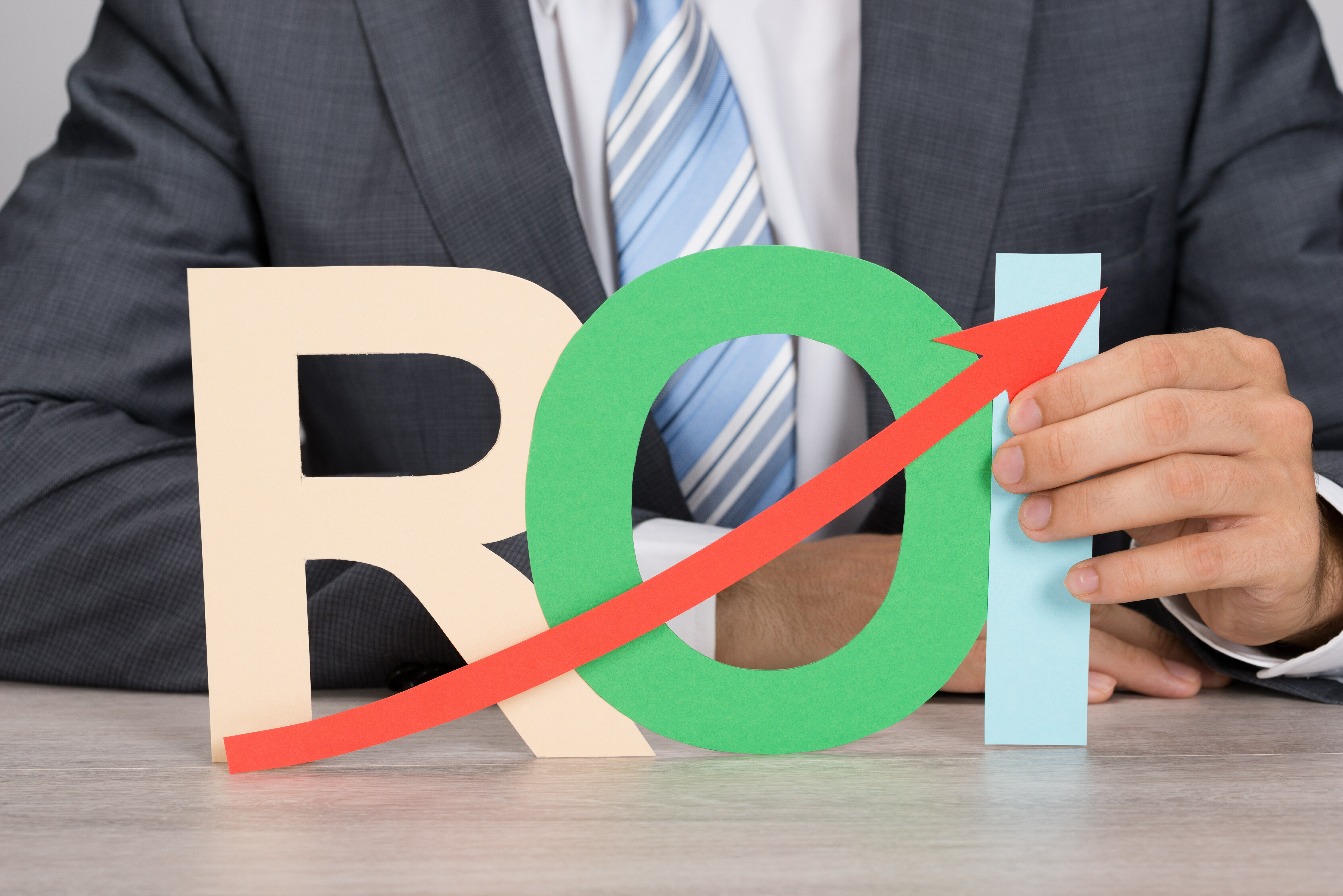 bigstock Businessman Holding Roi With U 77090189 What's Trending for Mainframes?