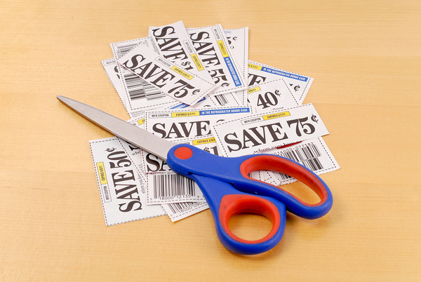 Multiple coupons with a pair of scissors.