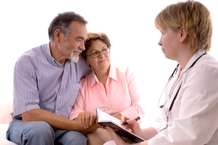 Older couple meeting with a doctor.