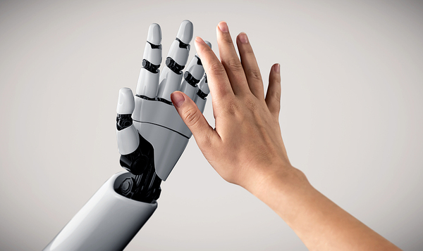 Human hand reaching out for a robotic hand.