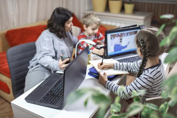 Parent helping children with school work.