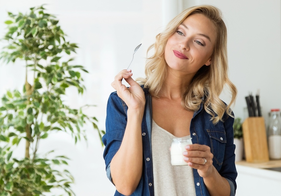 Woman eating yogurt.