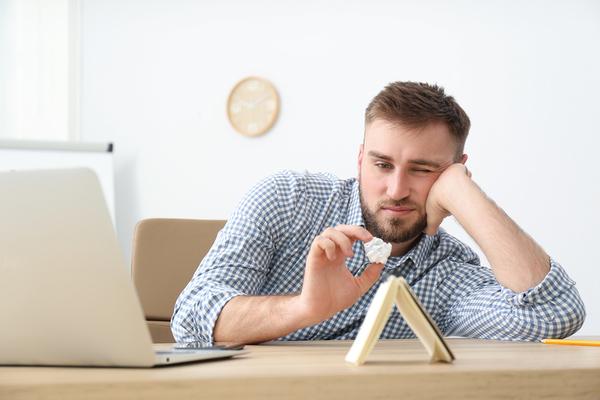 Man taking a mental break at his desk.