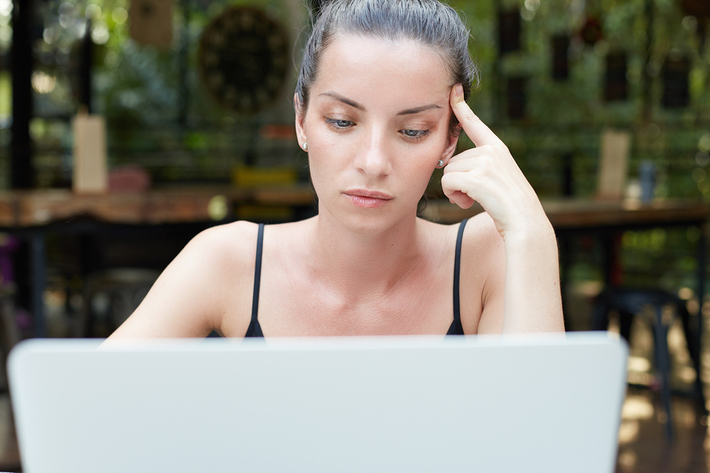 Woman looking at her laptop.
