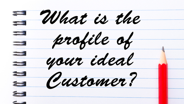 Notepaper with the words What is the profile of your ideal Customer? written.