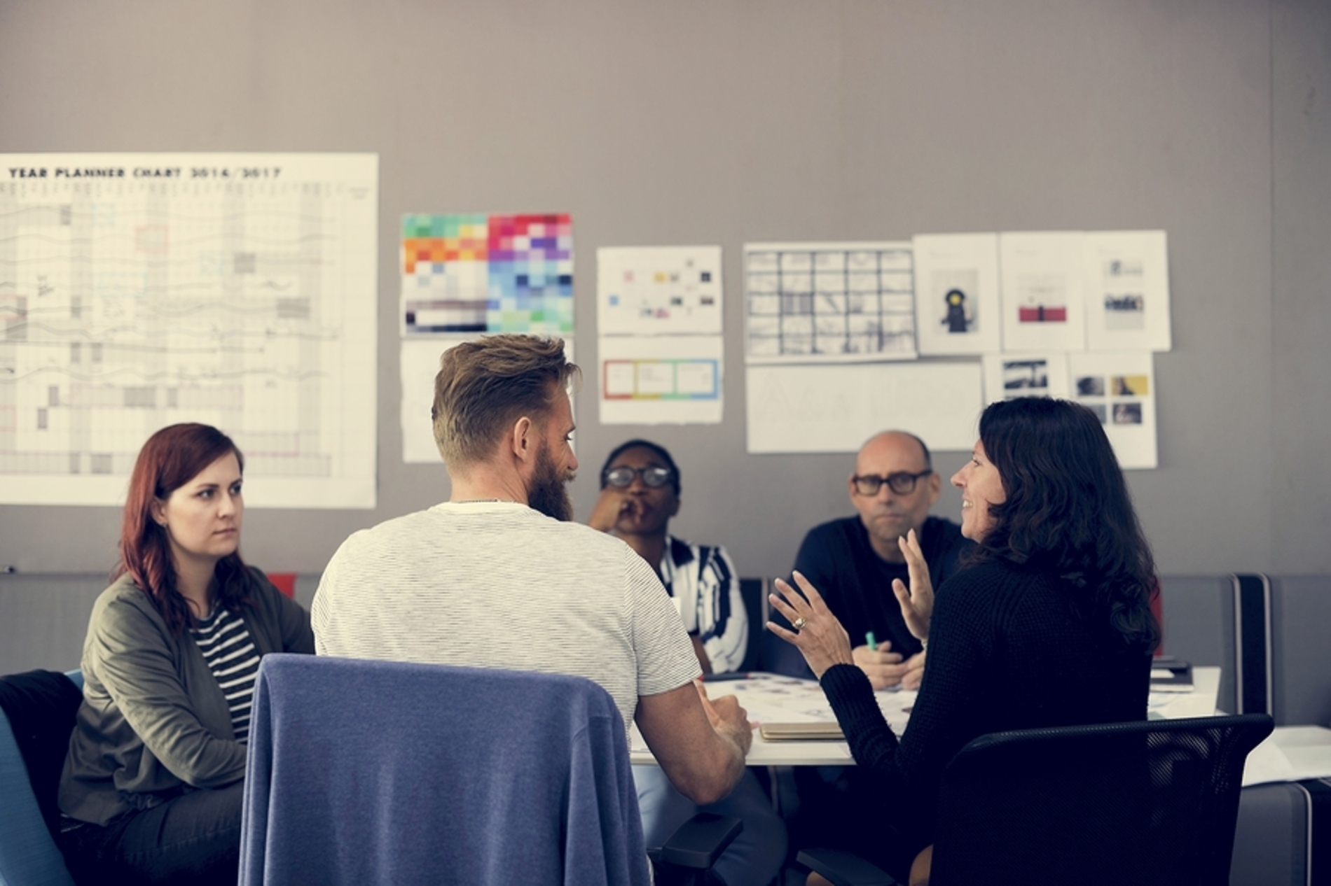 Group of colleagues discussing a project around a table.
