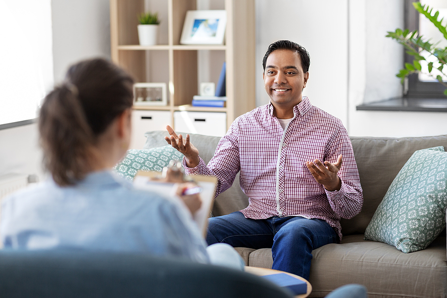Man having a discussion with a therapist.