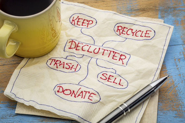 Napkin with notes, declutter, keep, recycle, trash, sell, and donate.