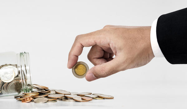 Person holding a coin.