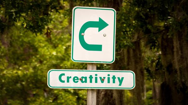 Creativity sign with a u turn arrow.