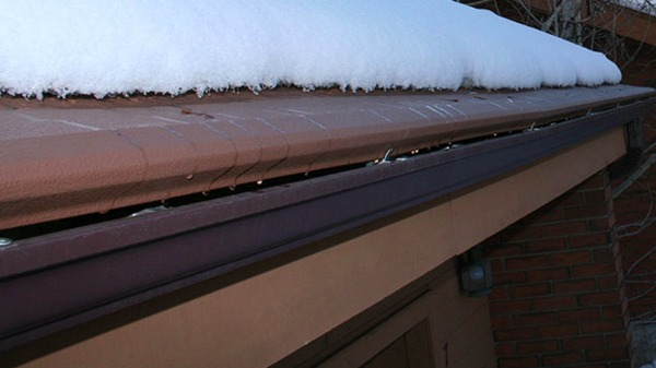Roof top with snow and gutter.