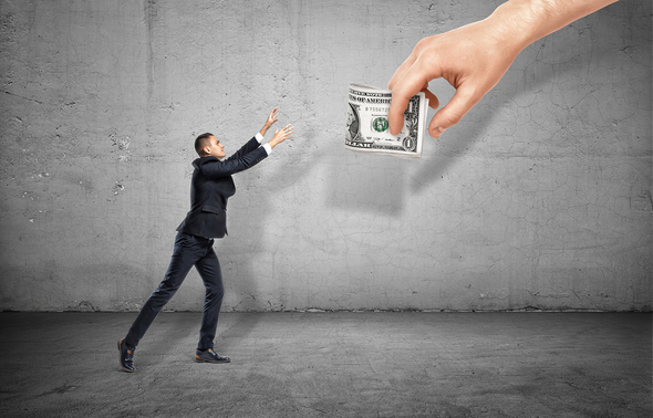 man grabbing money that is just out of reach