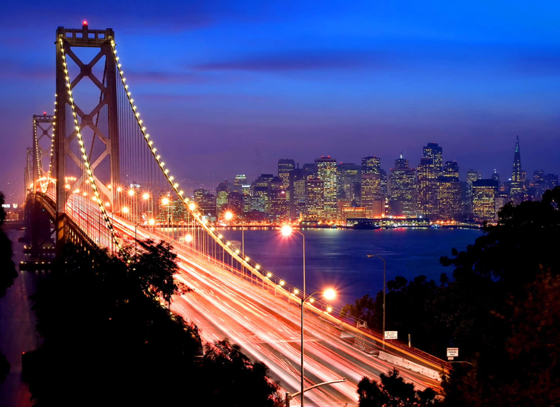 San Francisco bridge lit up at night.