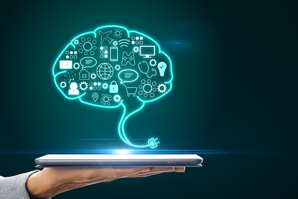 Illustration of a brain above a tablet.