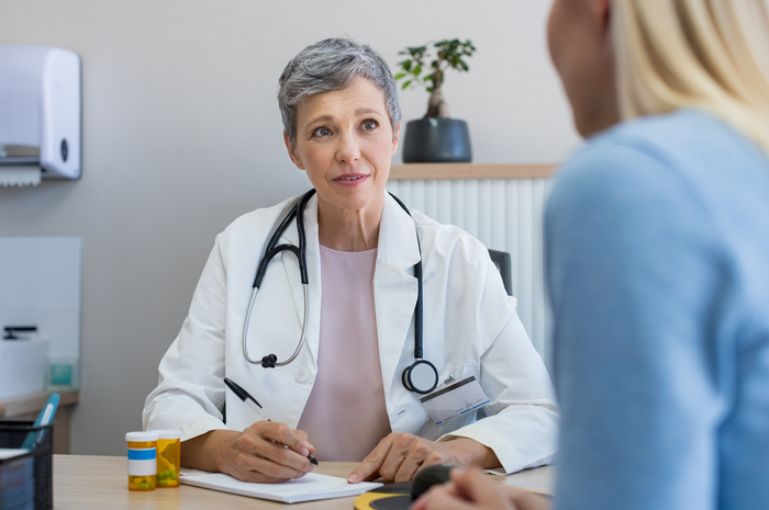Medical doctor interviewing patient.
