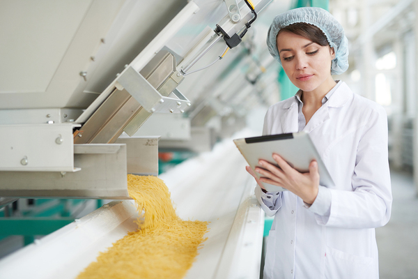 Factory worker using a tablet.