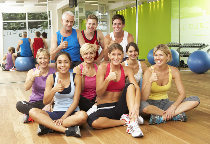 Group of people dressed for an exercise class.